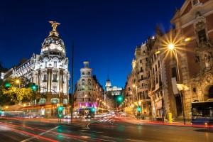 Rays of traffic lights on Gran via street, main shopping street in Madrid at night. Spain, Europe.